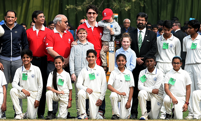 Justin and his kids posed for a photo with school children in New Delhi while at a cricket event on Feb. 22.
