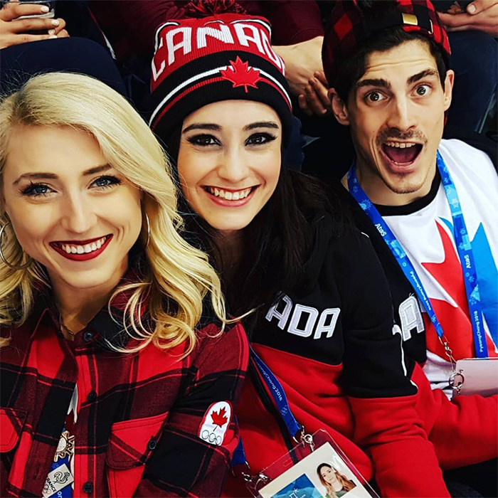 Kaetlyn cheered from the sidelines at the men's hockey game with fellow skaters Piper Gilles and Paul Poirier!