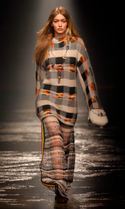 Gigi Hadid waltzed down the runway to open Missoni's fall/winter show in Milan on Feb. 24, where the 22-year-old donned a plaid sweater dress with flowing, matching knit pants.