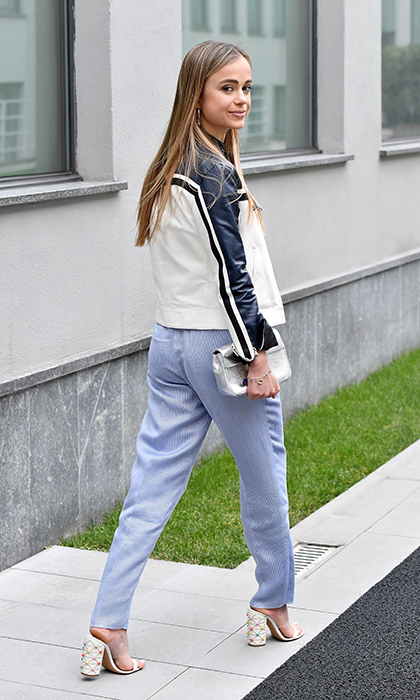 "Lady Amelia Windsor, once named by <em>Tatler</em> as the ""most beautiful member of the Royal Family,"" wore blue trousers and a motorcycle jacket to the Emporio Armani show.