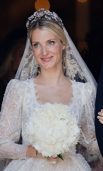 <p>The Prince's bride Ekaterina, a London-based fashion designer, was picture-perfect in a custom hand-embroidered Chantilly lace gown with pearl detail by Lebanese designer Sandra Mansour. Anchoring her stunning veil was a tiara worn by Princess Victoria Louise for her marriage to the groom's great-grandfather Ernst August III.</p>