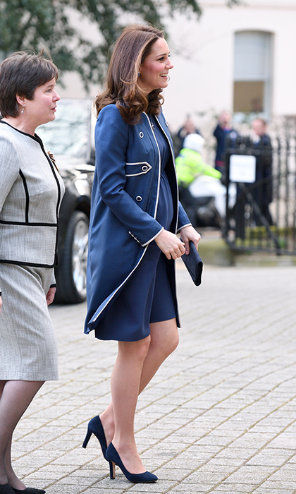 Duchess Kate braved the cold on Feb. 27 as she stepped out at her new patronage, the Royal College of Obstetricians and Gynaecologists (RCOG). The Duchess of Cambridge, who is supporting the Nursing Now campaign, looked beautiful in a blue military-style coat with white trim, a custom creation by Jenny Packham. Kate let the topper hang open over her perfectly coordinated blue dress, anchoring the look with a pair of blue Jimmy Choo heels. The stunning wife of Prince William completed her ensemble with a blue clutch bag.