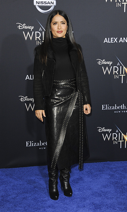 <p>Salma Hayek wore her own type of warrior style with a black turtleneck teamed with a leather studded midi skirt and boots.</p>