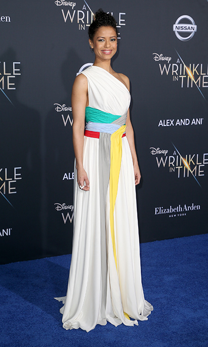 <p>Gugu Mbatha-Raw rocked a white goddess gown with multi-colored accents by Vionnet.</p>