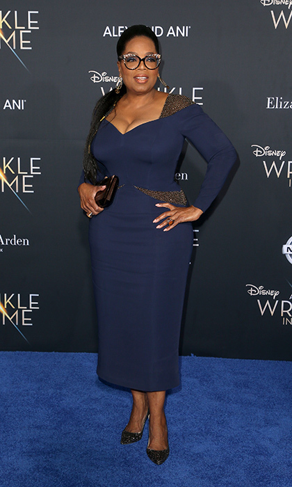 <p>Oprah Winfrey, who plays Mrs Which, looked elegant in a dark blue dress with gold details which she complemented with glittering eyeglasses and a braided hairstyle that took two hours to complete. </p>