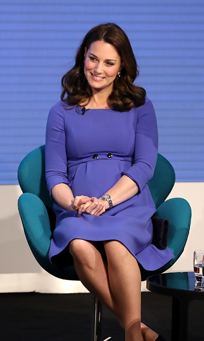 "Kate stunned in a recycled cornflower blue Seraphine dress, with dark suede heels and her classic loose curls. The Duchess was attending an event themed ""Making a Difference Together"" with Prince Harry, Meghan Markle and her husband, Prince William.
