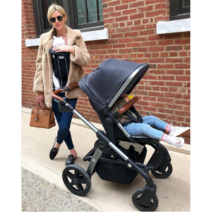In February 2018, Nicky Hilton shared a rare photo of her two children together. The stylish mom has little 10-week-old Teddy Marilyn nestled in a baby carrier, while big sister Lily Grace, 19 months, is comfy in a stroller. Nicky and husband James Rothschild welcomed little Teddy on December 20, 2017.