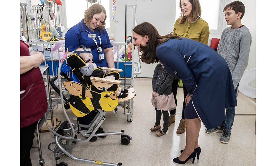 <p>Kate Middleton had a big smile for this sweet little patient, ten-month-old Amara Kedwell-Parsons, who was born prematurely, during a visit to the children's Snow Leopard ward at St Thomas' Hospital in London on February 27.</p>