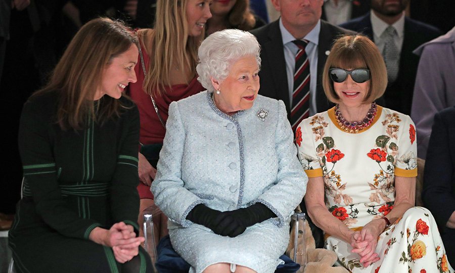 Queen Elizabeth II made a surprise appearance at London Fashion Week on Feb. 20 for Richard Quinn's runway show. Her Majesty sat between Caroline Rush, chief executive of the British Fashion Council, and the iconic Anna Wintour.