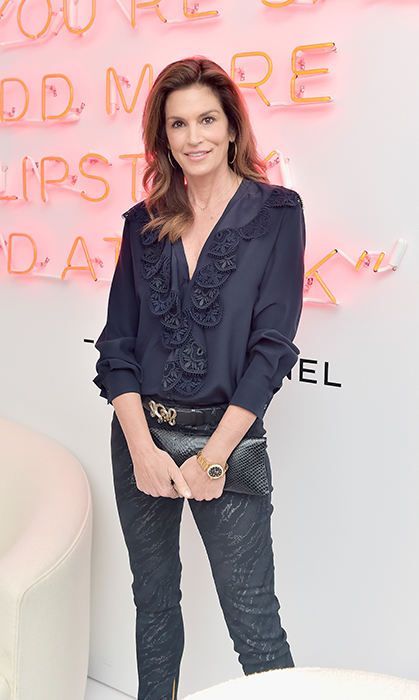 And what's a fashion show afterparty without the queen of style herself! Cindy Crawford donned a navy outfit to celebrate the Chanel show at its L.A. afterparty!