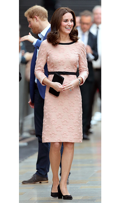 <p> In October 2017, Duchess Kate, in the early stages of her third pregnancy, was pretty in pink in an Orla Kiely dress for a surprise appearance at London's Paddington train station to meet the cast and crew of <em>Paddington 2</em>. </p>
