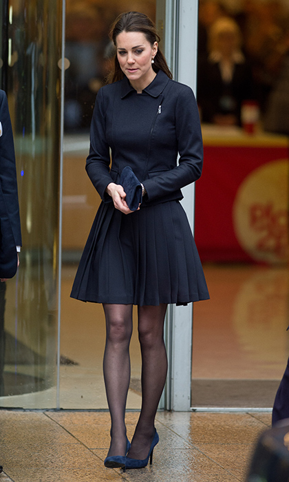 <p>The Duchess Of Cambridge wore this Orla Kiely crepe pleated skirt in navy blue for the Place2Be Forum at the offices of Clifford Chance, Canary Wharf in November 2013.</p>