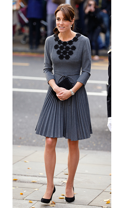 <p> Another of the Duchess Of Cambridge's favorite Orla Kiely dresses is this grey pleated creation with long sleeves and black daisy appliqué. Kate wore the design to the meet children and mentors from Chance UK's Early Intervention Program in London in October 2015.</p>