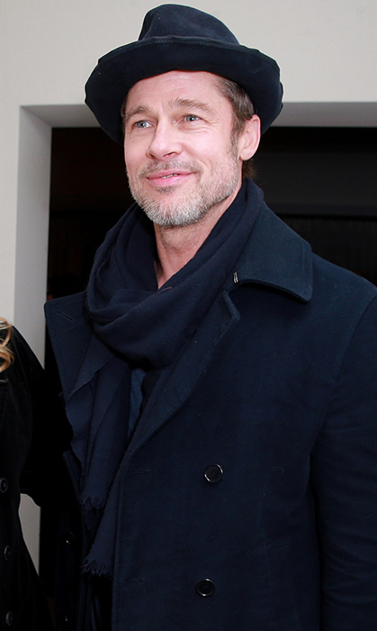 Brad Pitt made a dapper appearance at the Gersh party, too, clad in a distressed hat, black coat and matching scarf.