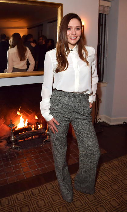 Elizabeth Olsen kept it sophisticated in tailored pants and a chic blouse at the Gersh pre-Academy Awards party.