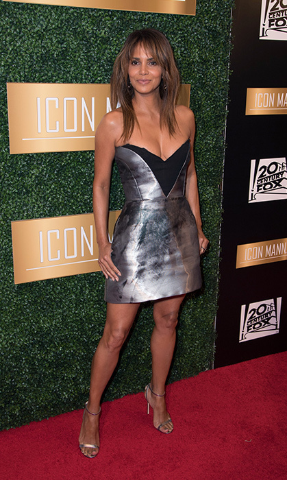 ICON MANN's 6th Annual Pre-Oscar Dinner took place at the Beverly Wilshire Four Seasons Hotel on Feb. 27. Halle Berry made a stunning entrance in a metallic minidress with a plunging neckline.