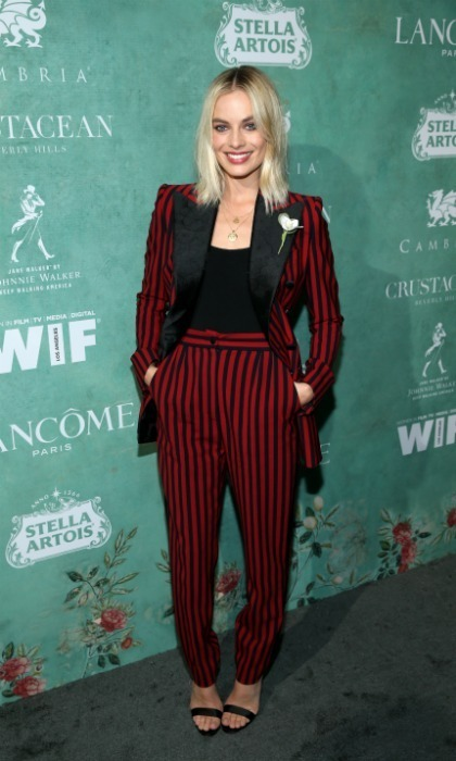 Pretty in pinstripes! Margot Robbie stepped out for the event in a sleek red and black number. The I,Tonya star kept her blonde tresses down for a casual touch.
