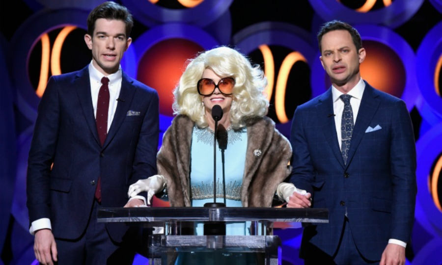 "Can you guess who's in the middle? Kristen Wiig joined hosts John Mulaney and Nick Kroll on stage during the show. The funny lady appeared dressed as 110-year-old ""film legend"" Fay Fontaine. The 44-year-old actress seemed to poke fun at Faye Dunaway's mishap at last year's Oscars.