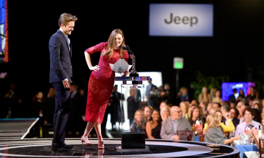 Robert Pattinson and Elizabeth Olsen made for a dynamic duo during the awards show, taking to the stage as presenters. Robert looked sharp in a suit, while Elizabeth donned a sleek red dress.