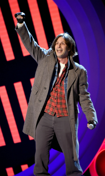 "Blast from the past! Andy Samberg hit the stage dressed as John Bender from <em>The Breakfast Club</em>. The SNL alum sang a parody of ""Don't You Forget About Me,"" begging the actors at the ceremony not to sell out to the ""magic of Hollywood."" He sang lines like: ""Don't you forget about us, Saoirse don't leave, don't put your face upon a bus.""