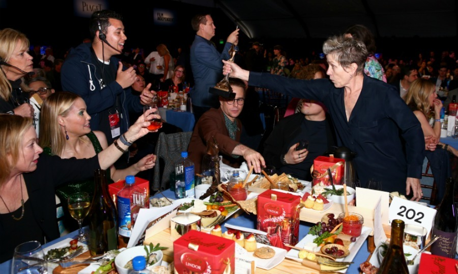 "<p>Cheers! Frances McDormand took home ""Best Female Lead"" for her performance in <em>Three Billboards Outside Ebbing, Missouri</em>. Notorious for mocking awards shows, Frances recalled the ""beach party"" she remembered the Spirit Awards used to be. She went on to imagine what it would be like if the show really was a beach party that you could go to in pajamas and slippers - which was exactly what she was wearing.</p>