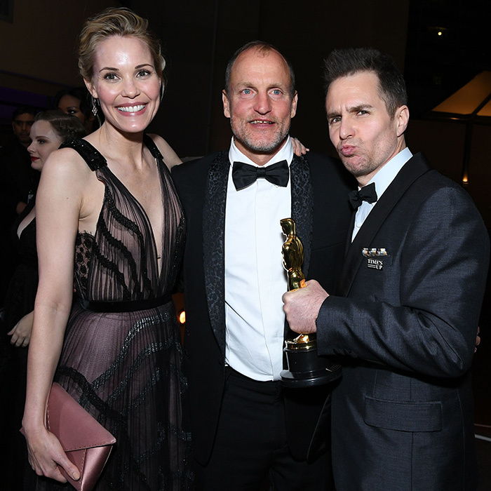 Sam Rockwell clutched his brand new Oscar as she joined wife Leslie Bibb and actor Woody Harrelson.