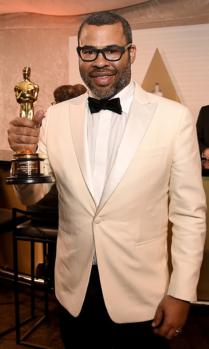 <i>Get Out</i> writer-director Jordan Peele proudly showed off his new Oscar, which he won for Best Original Screenplay.