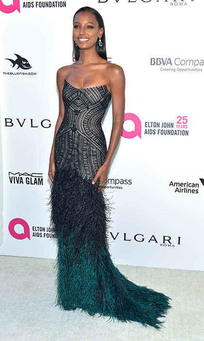 <p>Jasmine Tookes was picture perfect in a fitted Monique Lhuillier dress with feathered hem.</p>