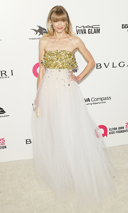 <p>Jaime King aws angelic in this white tulle dress with a gold-sequined top at Elton John's annual Oscars viewing party.</p>