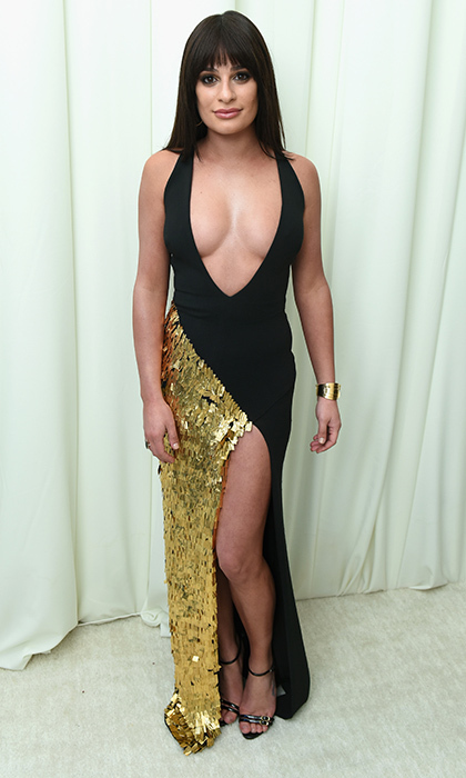 <p>Lea Michele turned heads in this daring black and gold sequin dress with a plunge neck and thigh-high slit.</p>