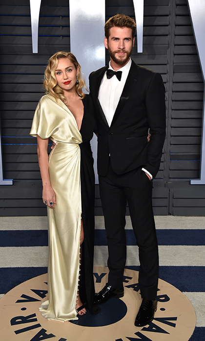 <p>Star couple Miley Cyrus and Liam Hemsworth were the image of old Hollywood glamour. Miley wore a stunning gold-and-black Prabal Gurung dress, while Liam looked handsome as ever in a Burberry tuxedo.</p>