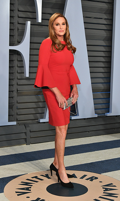 "<p>Caitlyn Jenner showed off a leggy look in a short red dress, paired with black heels and a personalized silver clutch that read ""Caitlyn.""</p>