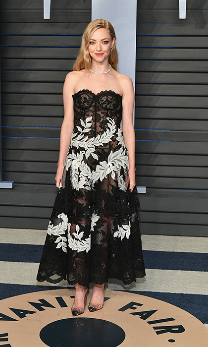 <p>Actress Amanda Seyfried went for a lingerie look in a black-and-white lace bustier Oscar de la Renta gown and Christian Louboutin heels.</p>