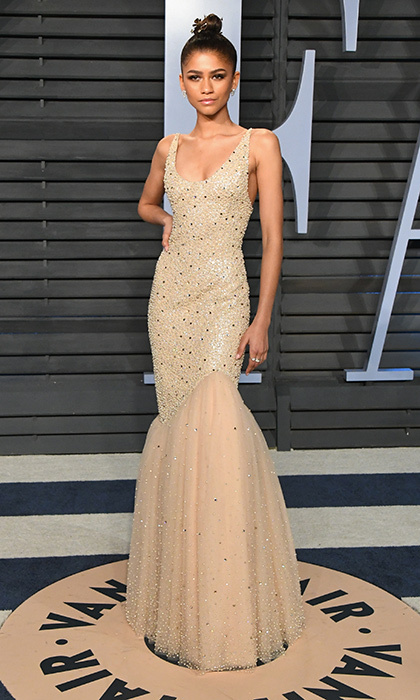 <p>Zendaya looked sleek in a glamorous Michael Kors nude-colored fishtail gown, while rocking an up-do that showed off her stunning features.</p>