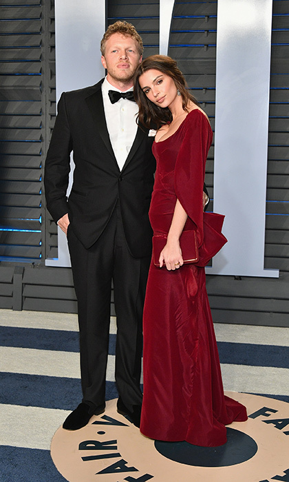 <p>Newlyweds Sebastian Bear-McClard and Emily Ratajkowski arrived at Wallis Annenberg Center for the Performing Arts with the bride looking radiant in a Zac Posen red velvet dress and matching clutch.</p>