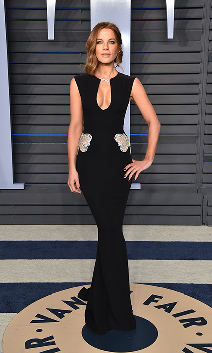 <p>Kate Beckinsale was flawless in this figure-hugging black Reem Acra Resort dress that showed off her amazing figure.</p>