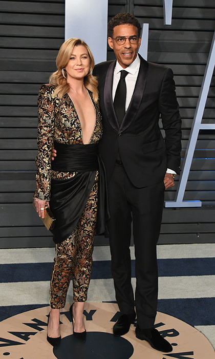 <p>Celeb couple Ellen Pompeo and Chris Ivery were a perfect match in black satin at the Vanity Fair party. Ellen wore a gold and black pantsuit with a plunging neckline and sash, while her husband looked smooth in a tux.</p>