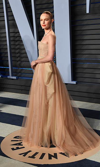 <p>Kate Bosworth looked elegant in a strapless nude tulle Christian Dior Couture gown and diamonds.</p>
