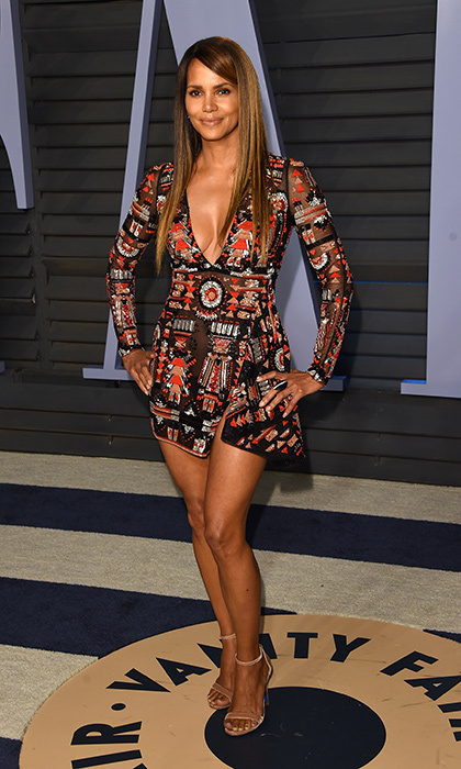 <p>Halle Berry stunned in a low cut Zuhair Murad dress and a sleek, straight hairstyle.</p>
