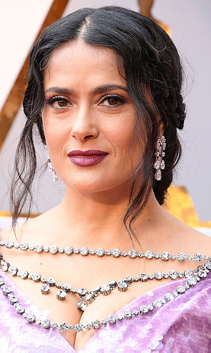 <p>If Salma Hayek's stunning Gucci gown wasn't bright enough, she decked herself out in some amazing jewels, too! The actress wore more than $4.2 million in Harry Winston diamonds, from her oval ring to her platinum earrings.</p>