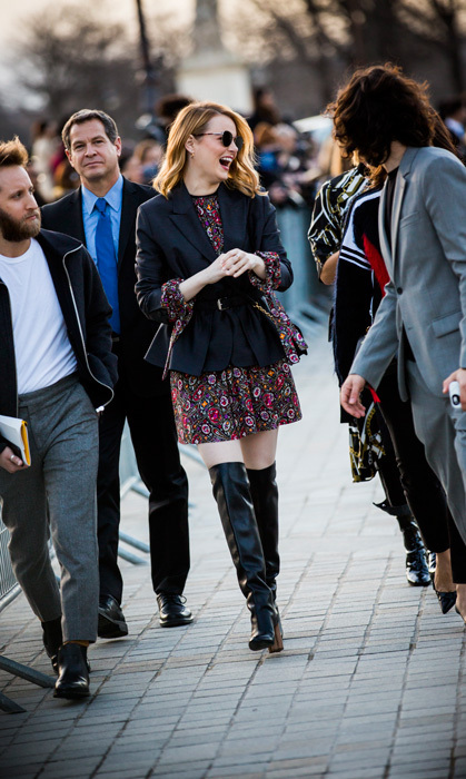 Emma Stone's smile radiated through the streets of Paris as she made her way into the Louis Vuitton presentation.