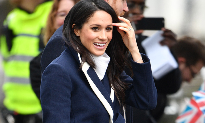 4c089552fc5cb6 Meghan Markle looks tres chic wearing navy and white J. Crew coat in  Birmingham