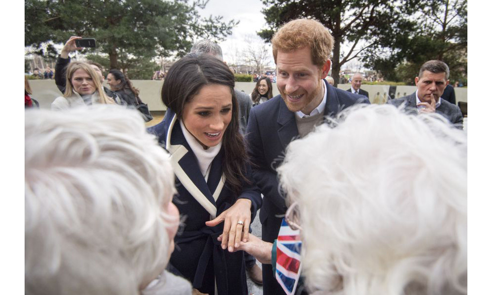 <p>Meghan appeared to show her beautiful engagement ring, which was designed by Prince Harry, to two elderly women who had waited in the city centre to meet the couple.</p>
