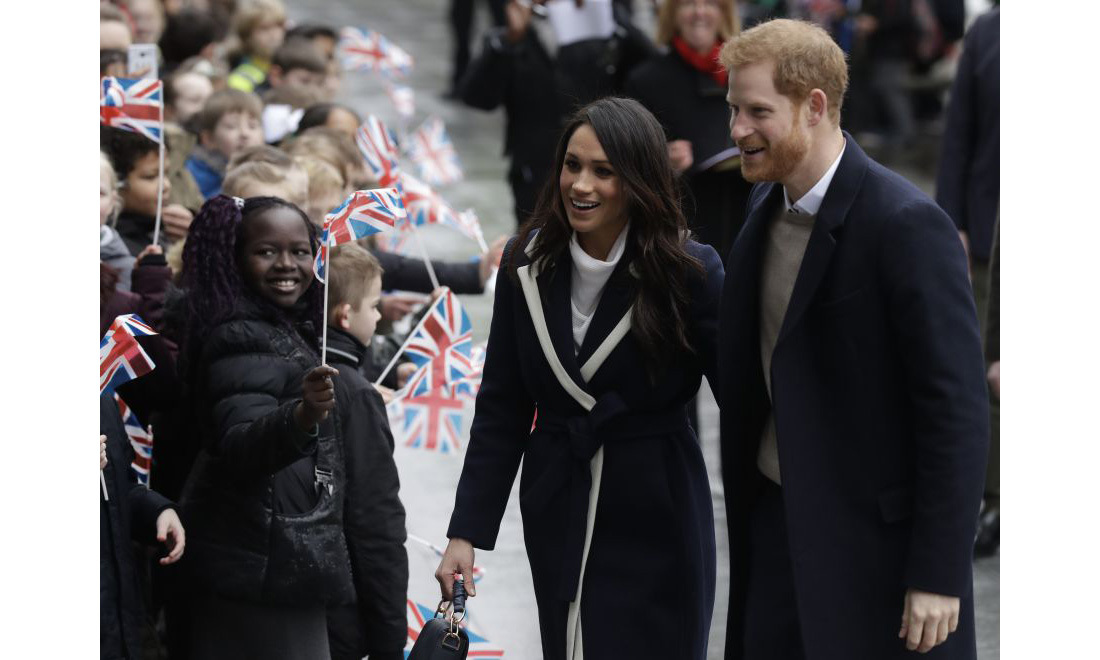 <p>Both Prince Harry and Meghan appeared in high spirits as they arrived in the city, and were greeted by hundreds of children waving Union Jack flags. The couple held hands and wrapped their arms around each other while walking into Millennium Point for their first engagement of the day.</p>