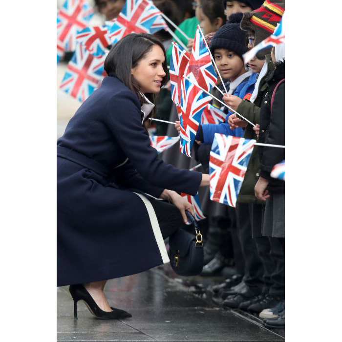 <p>Meghan happily chatted to groups of schoolchildren who had waited for hours to meet the couple. The former <em>Suits</em> star could be seen crouching down in order to talk to them better, even shaking hands with many of them.</p>
