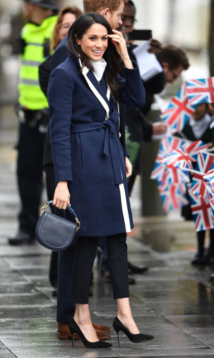 <p>Meghan looked typically stylish for the occasion, wearing a J Crew wrap coat, which she styled with black Alexander Wang cropped tuxedo style trousers and a jumper from high-street brand All Saints. The 36-year-old wore her hair down and loose wave, with natural makeup to complete the beautiful look.</p>