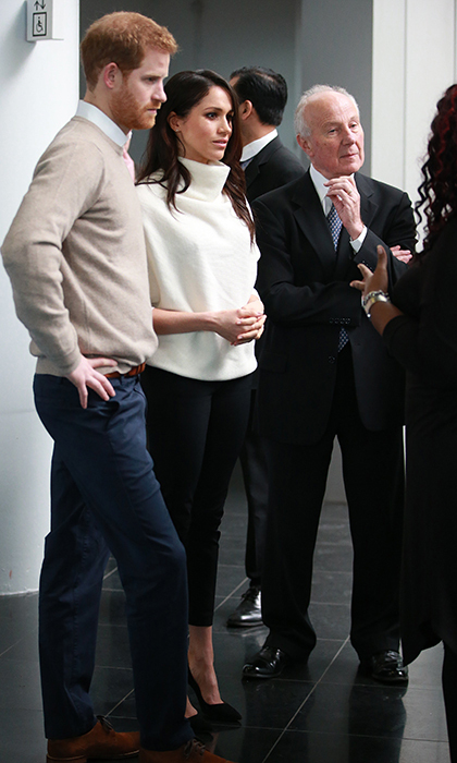 Meghan stunned in Alexander Wang pants and a cream sweater.