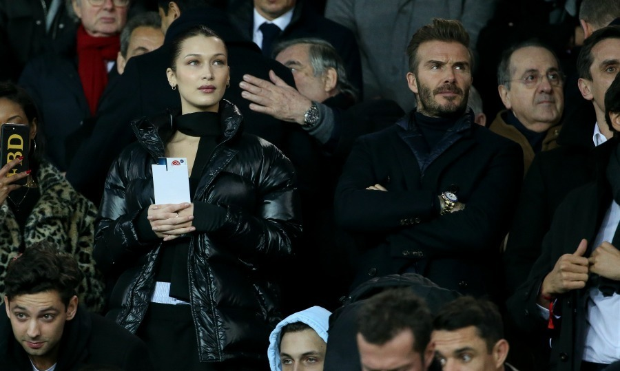 Fancy meeting you here! Bella Hadid and David Beckham sat side by side at the UEFA Champions League Round of 16 Second Leg match between Paris Saint-Germain (PSG) and Real Madrid at Parc des Princes stadium on March 6 in Paris, France. Photos captured the pair being introduced to each other, smiling as they shook hands and took their seats.