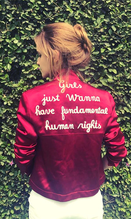 "A fierce feminist, Emma Watson showed off her jacket that reads, ""Girls just want have fundamental human rights"".
