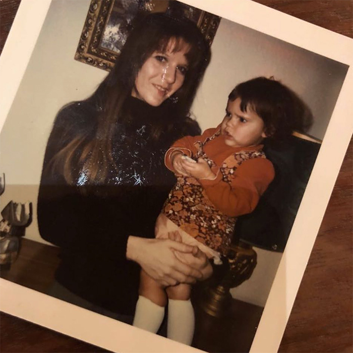 The apple doesn't fall far from the tree! Mother of four Victoria Beckham shared an old polaroid photo of her mom holding her as an infant.